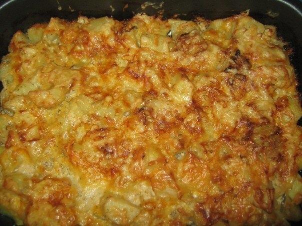 Фото к рецепту: Картошка запеченная в кефире под сыром